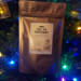 A Pouch of Pride and Peppermint Tea by a Christmas tree